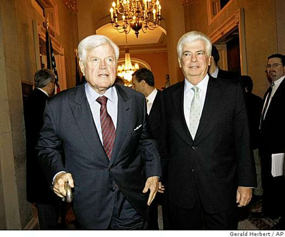 Sen. Edward Kennedy, D-Mass., left, and Sen. Christopher Dodd, D-Conn., arrive for a Democratic Caucus meeting on Capitol Hill in Washington, Tuesday, Nov. 18, 2008. (AP Photo/Gerald Herbert) Photo: Gerald Herbert, AP