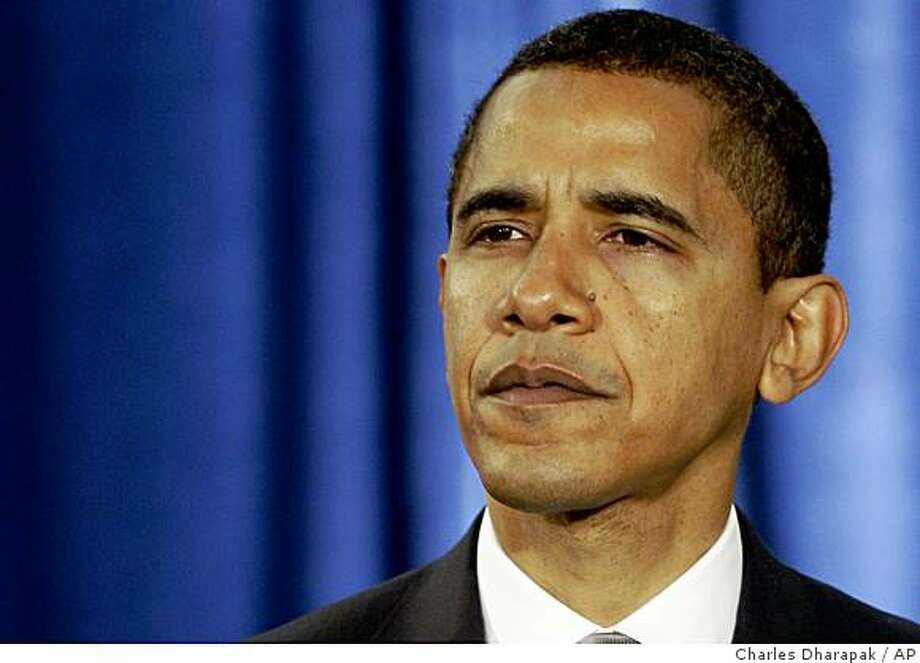 *(* FILE ** In this Nov. 26, 2008 file photo, President-elect Barack Obama listens to a reporter's question during a news conference in Chicago.   (AP Photo/Charles Dharapak, File) Photo: Charles Dharapak, AP