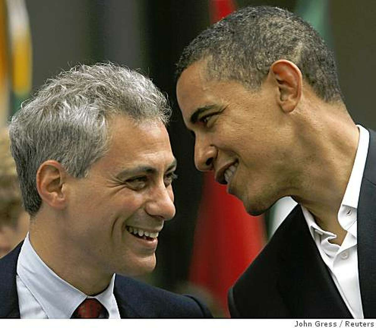 Democratic presidential nominee Senator Barack Obama (D-IL) (R) speaks with Representative Rahm Emanuel (D-IL) during a Chicago 2016 Olympics rally in Chicago in this June 6, 2008 file photo. Emanuel, a member of the Democratic leadership in the House of Representatives, has been offered the job to head President-elect Barack Obama's staff, party sources said. The sources said that the job was offered to Emanuel on November 5, 2008, just hours after Obama was elected, and Emanuel was expected to quickly accept the post of White House chief of staff. REUTERS/John Gress/Files (UNITED STATES) US PRESIDENTIAL ELECTION CAMPAIGN 2008 (USA)