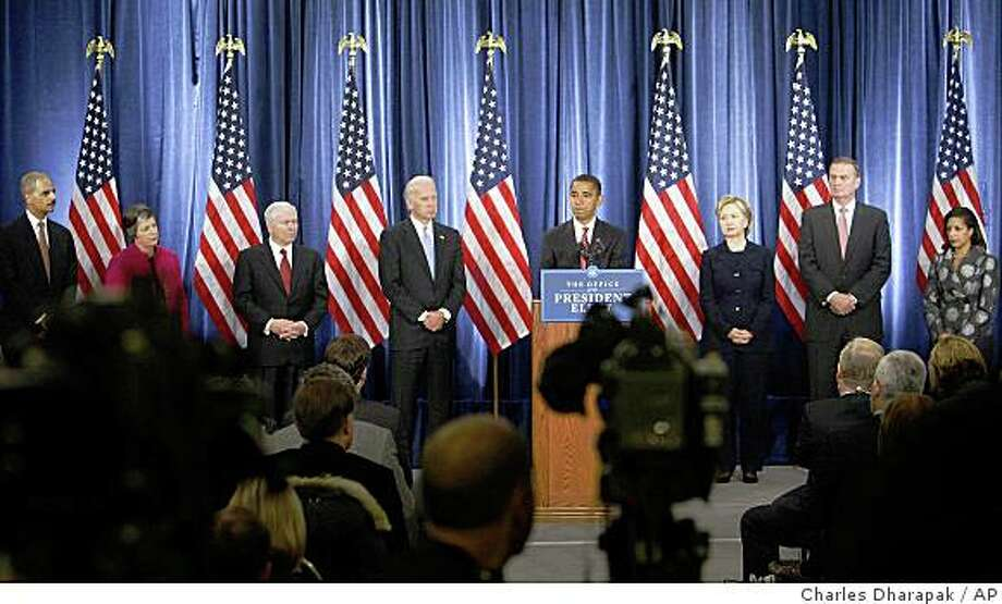 President-elect Barack Obama takes questions from reporters after announcing his new national security team at a news conference in Chicago, Monday, Dec. 1, 2008. From left to right are: Attorney General-designate Eric Holder; Homeland Security Secretary-designate Janet Napolitano; Defense Secretary Robert Gates; Vice President-elect Joe Biden; Obama; Secretary of State-designate Sen. Hillary Rodham Clinton, D-N.Y.; National Security Adviser-designate Ret. Marine Gen. James Jones; and United Nations Ambassador-designate Susan Rice. (AP Photo/Charles Dharapak) Photo: Charles Dharapak, AP