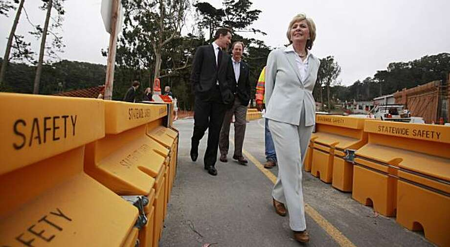 """Sen. Barbara Boxer (D-Calif.) tours the Doyle Drive project as she kicks off her """"Jobs For California"""" tour in San Francisco, Tuesday, July 6, 2010. Boxer toured the Doyle Drive project under construction that leads to the Golden Gate Bridge. She campaigned to create jobs and turn the economy around. In background on left is San Francisco Gavin Newsom. Photo: Paul Sakuma, AP"""