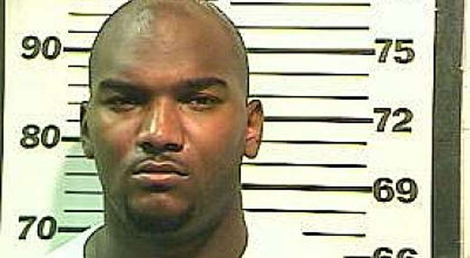 In this photo released by Mobile (Ala.) County Sheriff's Office shows JaMarcus Russell on Monday, July 5, 2010 in Mobile, Ala.  Russell has been arrested on a drug charge in Alabama. Mobile County Sheriff's spokeswoman Lori Myles said the 24-year-old football player was arrested Monday, July 5, 2010,  at his home during an undercover investigation. He is charged with possession of a controlled substance. Photo: AP