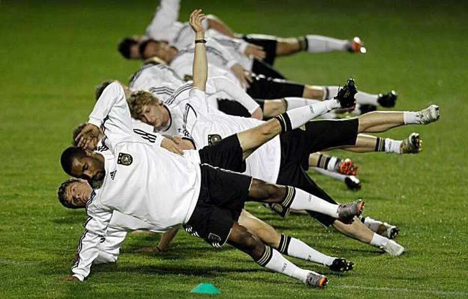 From front to back, Germany's Cacau, Thomas Mueller, Stefan Kiessling, and other players warm up during the last team training session of the German national soccer team before the semifinal of the soccer World Cup match between Germany and Spain in Durban near Pretoria, South Africa, Tuesday, July 6, 2010. Photo: Gero Breloer, AP
