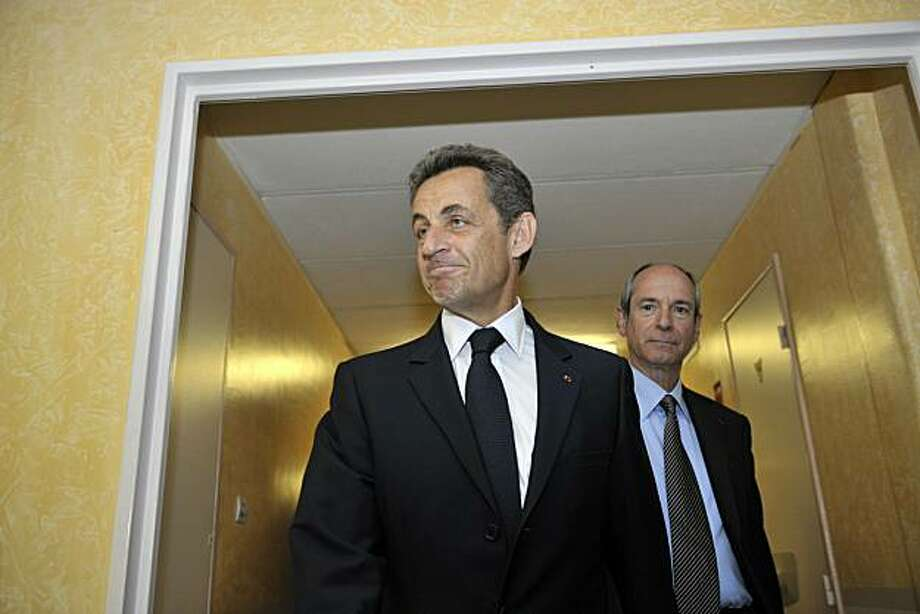 French President Nicolas Sarkozy visits with local deputy Guy Geoffroy  the Brie-Comte-Robert hospital on July 6, 2010, some 30km east of Paris. Sarkozy rejected today allegations that he and his party treasurer received illegal campaign donations, branding them political smears.  An accountant, identified by the investigative website Mediapart as Claire T., said Eric Woerth, a Sarkozy ally and treasurer of his UMP party, received the donation in March 2007, ahead of Sarkozy's election victory in May. Photo: Bertrand Langlois, AFP/Getty Images