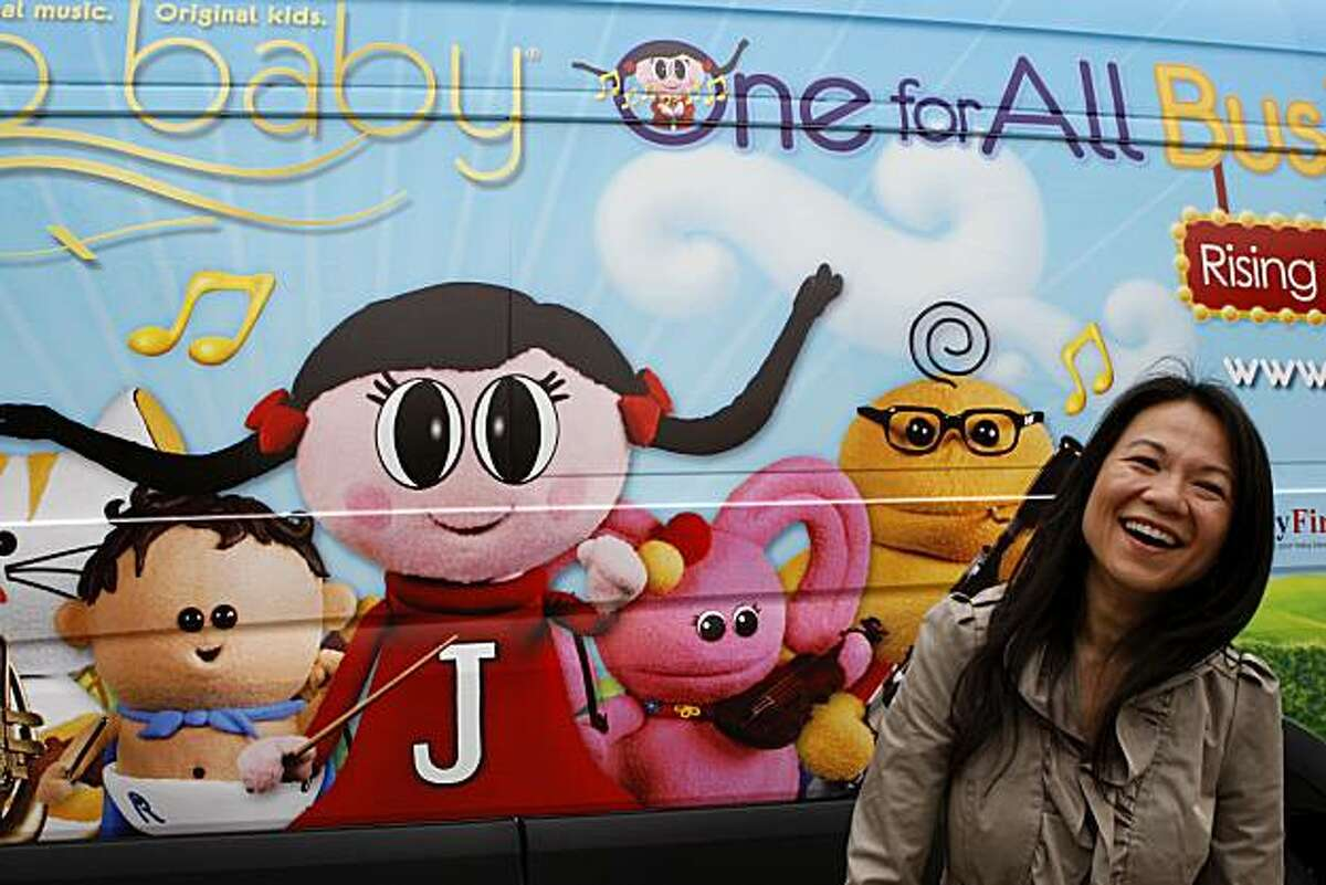 Juno Baby Founder Belinda Takahashi stands in front of the Juno Baby Bus parked at Zeum Children's Museum during the One For All Tour kick off on Friday, June 25, 2010 in San Francisco, Calif.