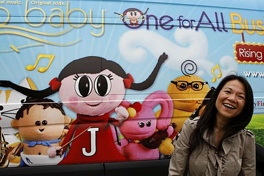 Juno Baby Founder Belinda Takahashi stands in front of the Juno Baby Bus parked at Zeum Children's Museum during the One For All Tour kick off on Friday, June 25, 2010 in San Francisco, Calif. Photo: John Sebastian Russo, The Chronicle