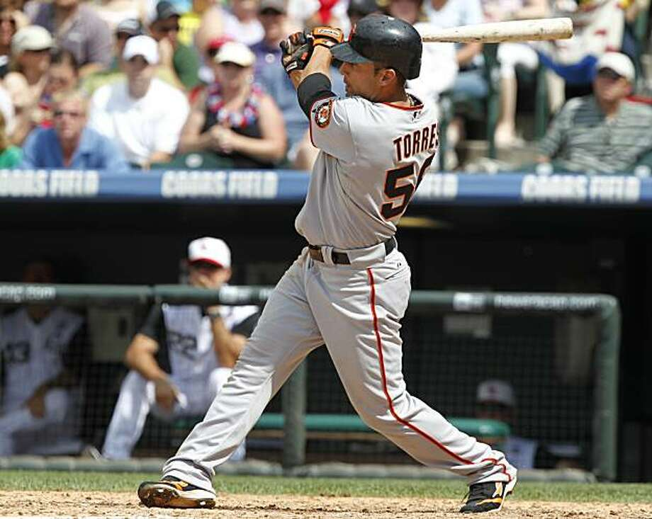 San Francisco Giants' Andres Torres connects for an  inside-the-park home run against the Colorado Rockies in the eighth inning of the Rockies' 4-3 victory in 15 innings of a baseball game in Denver on Sunday, July 4, 2010. Photo: David Zalubowski, AP