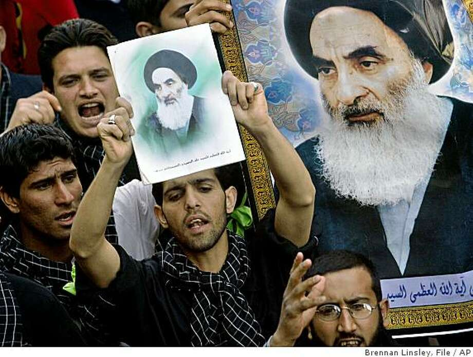 """**FILE** This is a  Feb. 29, 2004 file photo, showing Iraqi Shiite Muslims marching in support of Ayatollah Ali al-Sistani, displaying images of him at a rally in Najaf, Iraq. An official close to Grand Ayatollah Ali al-Sistani said Saturday, Nov. 29, 2008, that Iraq's most influential Shiite cleric has """"concerns"""" about the U.S.-Iraqi security pact. But the official says al-Sistani will let Iraqis decide the fate of the agreement to let U.S. forces stay in Iraq for three years in a nationwide referendum to be held by July 30. (AP Photo/Brennan Linsley, File) Photo: Brennan Linsley, File, AP"""