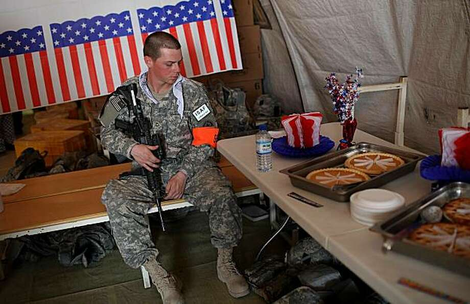 KANDAHAR, AFGHANISTAN - JULY 04:  U.S. Private First Class Thomas Baur provides security in a tent with tables of desserts during an Independence Day BBQ for troops at Kandahar Airfield July 4, 2010 in Kandahar, Afghanistan. Troops stationed at Kandahar Airfield were treated to a BBQ dinner and entertainment to celebrate Independence Day. Gen. David Petraeus formally assumed command of the 130,000-strong international force in Afghanistan today replacing Gen. Stanley McChrystal. Photo: Justin Sullivan, Getty Images