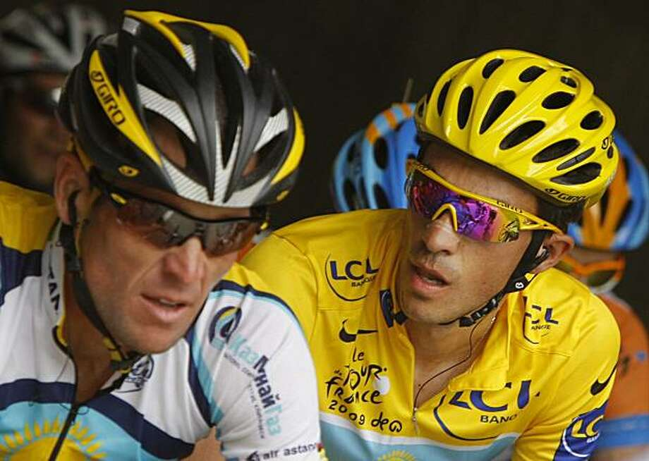 FILE - In this July 21, 2009, file photo, Alberto Contador, right, of Spain, wearing the overall leader's yellow jersey, looks at American seven-time Tour de France winner Lance Armstrong, as they climb Grand-Saint-Bernard pass during the 16th stage of the Tour de France cycling race over 159 kilometers (98.8 miles) which started in Martigny, Switzerland and finished in Bourg-Saint-Maurice, France. Armstrong is giving the Tour de France one last go, and two-time winner Alberto Contador is the man to beatagain when the three-week cycling extravaganza starts on Saturday. Photo: Christophe Ena, File, AP