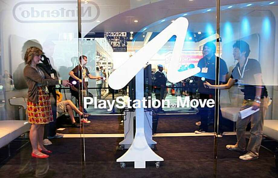 Visitors test the Sony Playstation Move at the 2010 E3 in Los Angeles on June 15, 2010. A stage for new blockbuster titles, the Electronic Entertainment Expo (E3) is an arena where Sony, Microsoft and Nintendo duel with motion-sensing controls for rival PlayStation 3, Xbox 360, and Wii consoles. Photo: Valerie Macon, AFP/Getty Images