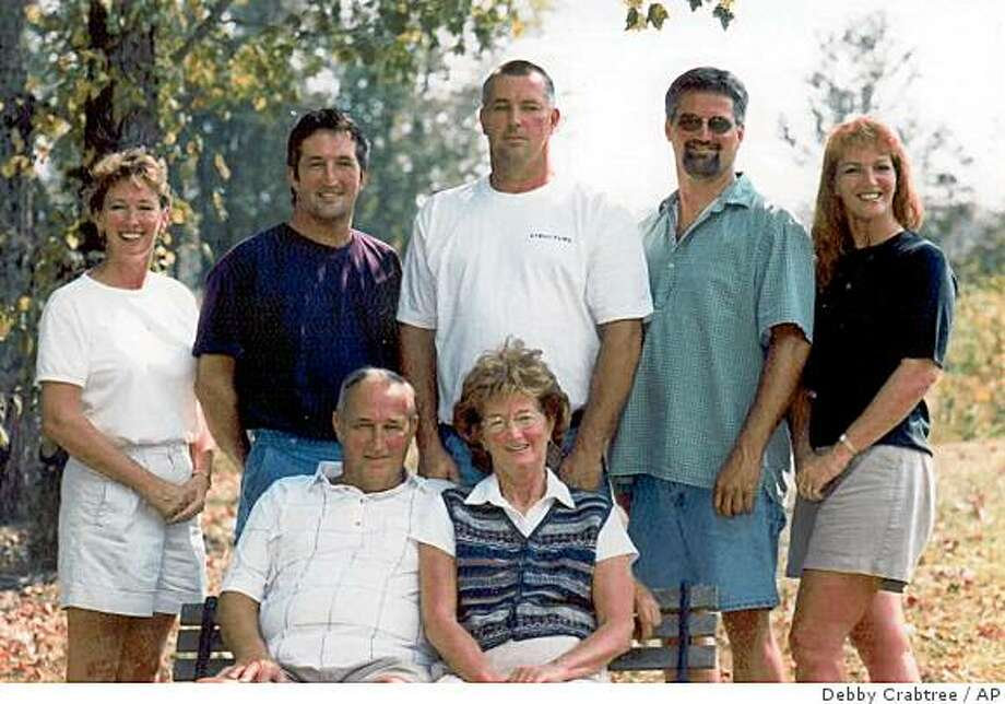 **ADVANCE FOR SUNDAY, NOV. 30**  In this photo released by Debby Crabtree, her family is seen at the family farm in 1999.  Her parents Dave Sr. and Carol Evans sit in front and their children in the back from left, Debby Crabtree, David Evans Jr., Mike Evans, Randy Evans, Ellen McCabe. Police say Carol Evan's husband David Evans hired someone to kill her. (AP Photo/Debby Crabtree) **NO SALES** Photo: Debby Crabtree, AP