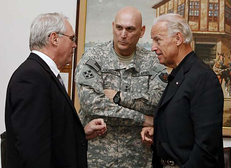 U.S. Vice President Joe Biden, right, Gen. Ray Odierno, center, and U.S. Ambassador to Iraq Christopher Hill, left, confer at the embassy in Baghdad, Iraq, Saturday, July 3, 2010. Vice President Joe Biden landed Saturday in Baghdad to coax Iraqi leaders into ending their government impasse as vying political factions remain deadlocked over which political bloc should pick its new leaders, including prime minister. Photo: Hadi Mizban, AP