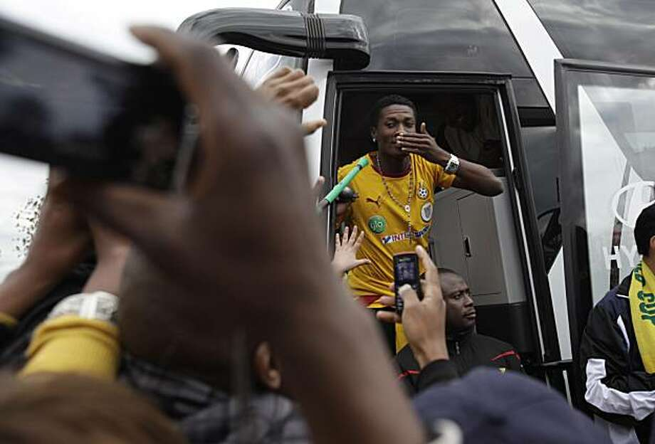 Ghana's Asamoah Gyan blows kisses to fans as the Ghana national soccer team greets supporters in Soweto Township in Johannesburg, South Africa Sunday, July 4, 2010.  The Ghanaian team became the third African team ever to reach the World Cup quarterfinalround, where they were defeated by Uruguay. Photo: Rebecca Blackwell, AP