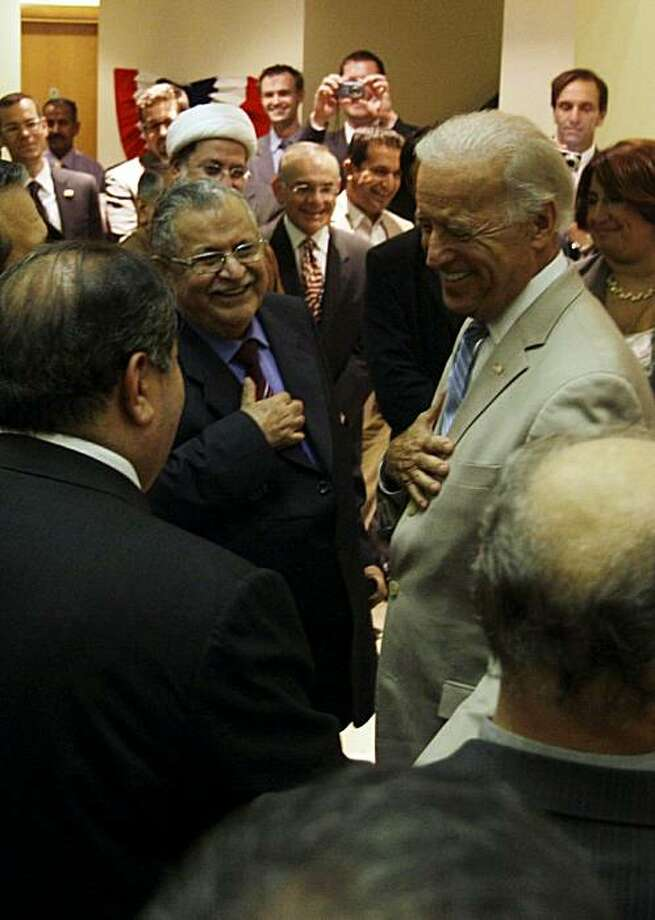 Iraqi President Jalal Talabani (C-L) greets US Vice President Joe Biden (R) at a reception in Baghdad on July 4, 2010 after the latter's meeting with the two men vying to lead Iraq, former premier Iyad Allawi and incumbent Prime Minister Nuri al-Maliki. Photo: Ali Al-saadi, AFP/Getty Images