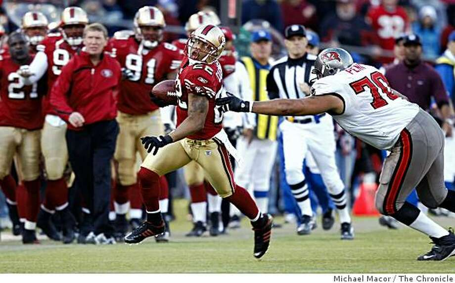 49ers_buccaneers_009_mac.jpg San Francisco 49ers Nate Clements (22) returns an interception 61 yards in 4th quarter to set up a San Francisco 49ers Frank Gore (21) touchdown. Chased by Tampa Bay's, Donald Penn (70). The San Francisco Forty Niners vs. The Tampa Bay Buccaneers at Monster Park. NFL Football. Michael Macor / The Chronicle Photo taken on 12/23/07, in San Francisco, CA, USA Photo: Michael Macor, The Chronicle