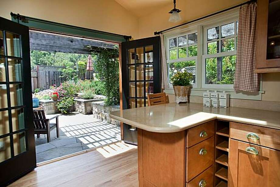French doors open to the rear patio from the kitchen. The property also includes multiple decks. Photo: Susanna Frohman, Www.susannafrohman.com