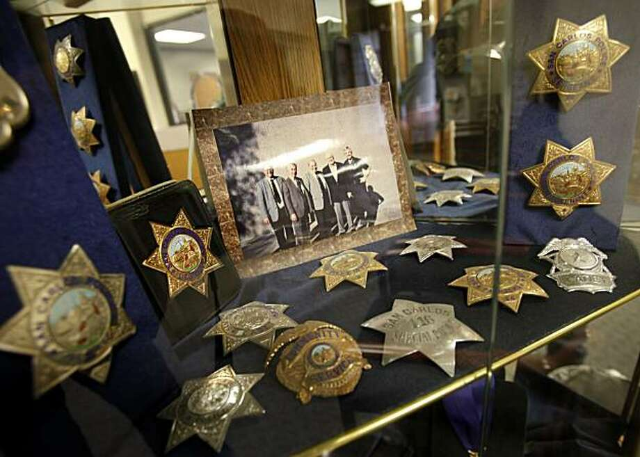 A display case in San Carlos City Hall Thursday May 27, 2010 celebrates the past glory of the police department including a photo of the chiefs. Ed Estrada, who has been in law enforcement over 20 years, is one of only four officers in the San Carlos police. The San Carlos, Calif. police department is in danger of being disbanded because of budget cuts. Photo: Brant Ward, The Chronicle