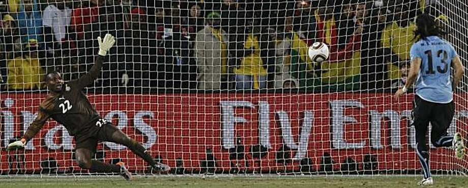 Uruguay's Sebastian Abreu, right, scores against Ghana goalkeeper Richard Kingson, left, in a penalty shootout during the World Cup quarterfinal soccer match between Uruguay and Ghana at Soccer City in Johannesburg, South Africa, Friday, July 2, 2010. Uruguay reached the World Cup semifinals for the first time since 1970, beating Ghana 4-2 on penalties after a 1-1 draw Friday. Photo: Ivan Sekretarev, AP