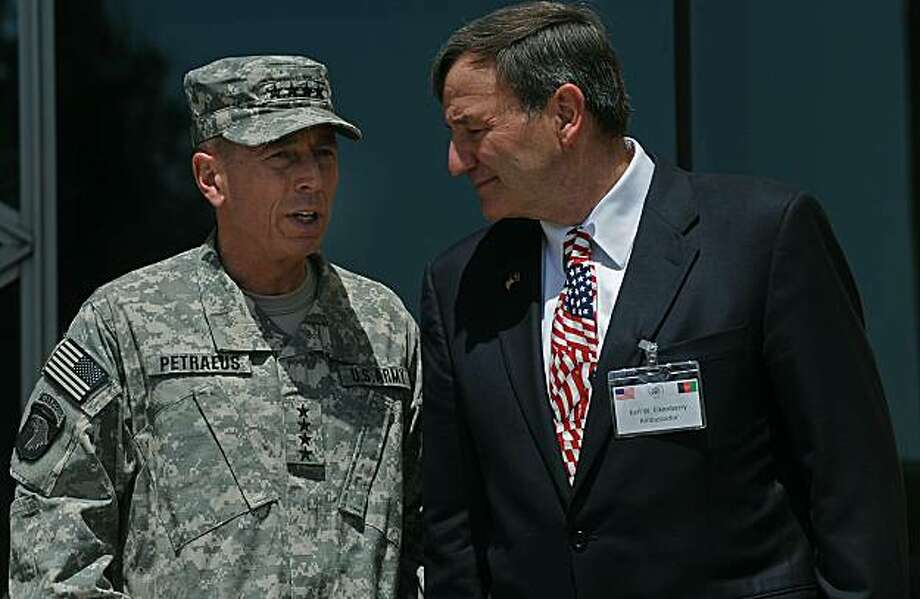 """Incoming Commander of US and NATO troops in Afghanistan, US General David Petraeus (L) talks to US Ambassador to Afghanistan, Karl Eikenberry (R) at The US embassy in Kabul on July 3, 2010.  Petraeus has called for a united effort in the Afghan war as hemade his public debut on Saturday as the NATO commander in Afghanistan. """"This is an effort in which we must achieve unity of effort and common purpose. Civilian and military, Afghan and international, we are part of one team with one mission,"""" said Petraeus. Photo: Massoud Hossaini, AFP/Getty Images"""