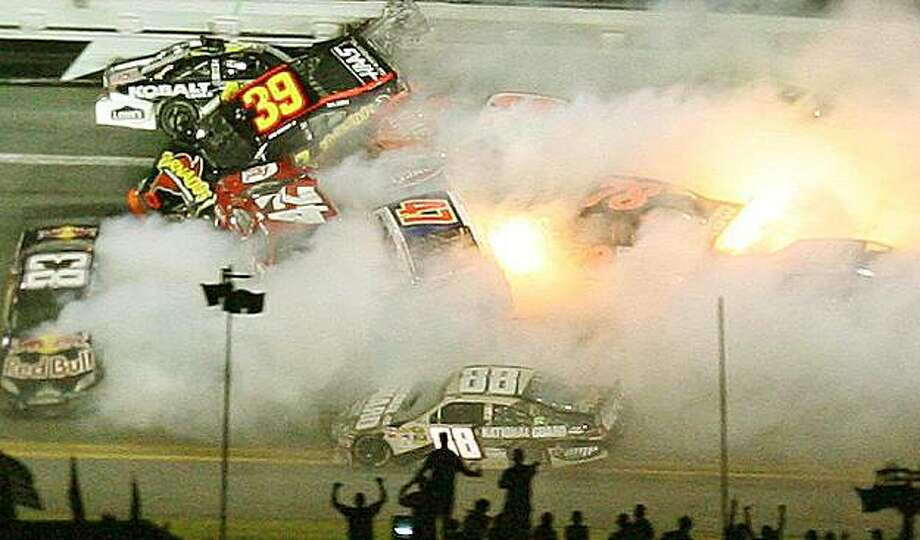 Several cars crash and burn during a wreck in the final laps of the Coke Zero 400 at Daytona International Speedway in Daytona Beach, Florida, on Saturday, July 3, 2010. (Stephen M. Dowell/Orlando Sentinel/MCT) Photo: Stephen M. Dowell, MCT