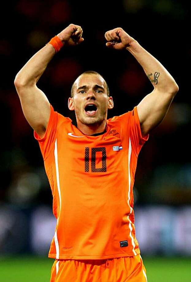 CAPE TOWN, SOUTH AFRICA - JULY 06:  Wesley Sneijder of the Netherlands celebrates victory and progress to the final during the 2010 FIFA World Cup South Africa Semi Final match between Uruguay and the Netherlands at Green Point Stadium on July 6, 2010 inCape Town, South Africa. Photo: Lars Baron, Getty Images