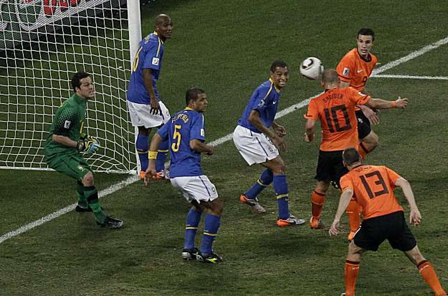 Netherlands' Wesley Sneijder, center right, scores a goal past Brazil goalkeeper Julio Cesar, left, during the World Cup quarterfinal soccer match between the Netherlands and Brazil at Nelson Mandela Bay Stadium in Port Elizabeth, South Africa, Friday, July 2, 2010. Photo: Michael Sohn, AP
