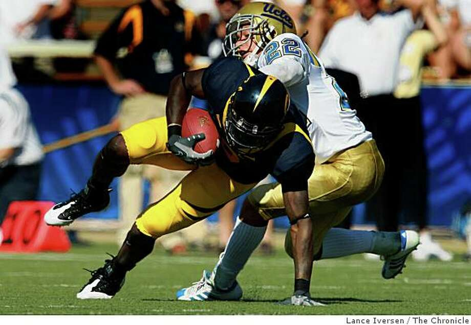 Cal's Nyan Boateng keeps his balance and spins out of a UCLA tackle for a first down in the first half of the Bears 41-20 victory over UCLA  in Berkeley, Calif., on Saturday, October 25, 2008. Photo: Lance Iversen, The Chronicle