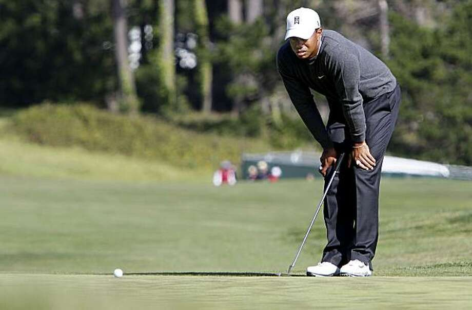 Tiger Woods looks over his putt on the 13th green during  day 1 of the 2010 US Open Golf Tournament in Pebble Beach, Ca. on Thursday June 17, 2010. Photo: Michael Macor, The Chronicle