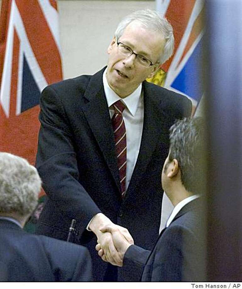 Canadian Liberal party leader Stephane Dion shakes hands with caucus members following a party caucus meeting on Parliament Hill, in Ottawa Monday Dec. 1, 2008. The Liberals have said they have agreed to form a coalition government with the New Democrats backed by the Bloc Quebecois with Dion as leader.(AP Photo/ The Canadian Press,/Tom Hanson) Photo: Tom Hanson, AP