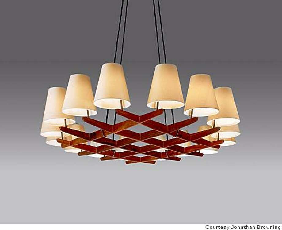 The Hallstadt Rosewood chandelier is among 11 new designs by San Francisco lighting designer Jonathan Browning who adpated his series from archival designs by the 127-year old Viennese lighting company J. T. Kalmar with whom he is now closely affiliated. The chandelier is composed of hand-crafted silk, wood and bronze components as are the other sconces, floor lamps and chandeliers in the series. Photo: Courtesy Jonathan Browning