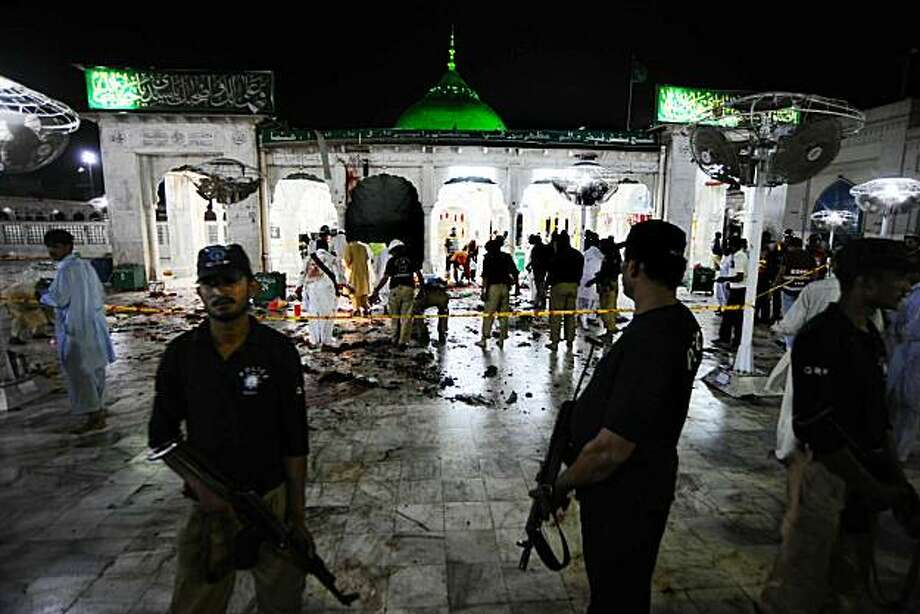 Pakistani security officials examine the site of suicide bomb attacks at the Saint Syed Ali bin Osman Al-Hajvery shrine, popularly known as Data Ganj Bakhsh in Lahore on July 2, 2010. At least 35 people were killed on July 2 in three suicide attacks at the tomb of an Islamic saint in the eastern Pakistani city of Lahore, a city official said, raising a previous toll of 25 from the police.   TOPSHOTS / Photo: Arif Ali, AFP/Getty Images