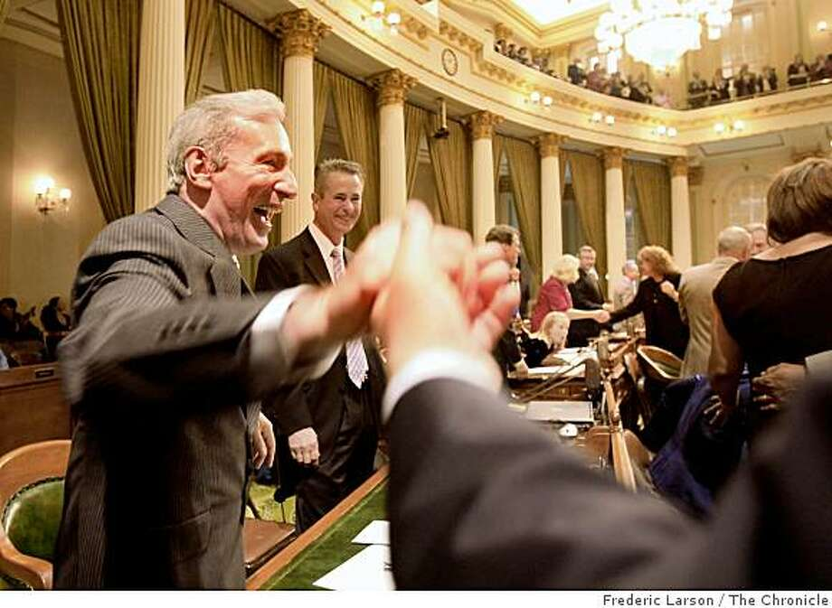 Tom Ammiano of San Francisco, who was newly elected to the California Assembly, celebrates with other Assembly members on the floor after taking the oath of office in the Assembly Chambers at the State Capital Building in Sacramento, Calif., on December 1, 2008. Photo: Frederic Larson, The Chronicle