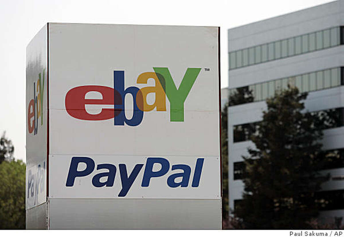 **FILE** In this May 8, 2008 file photo, an Ebay/PalPal sign stands outside Ebay offices in San Jose, Callif. EBay plans to move nearly all transactions to electronic payment methods. Beginning in the U.S. in mid-October, users will have to pay by credit card, PayPal or the credit card processing service ProPay. No more cash, checks or money orders _ which account for less than 10 percent of eBay transactions these days _ unless sellers and buyers meet in person. (AP Photo/Paul Sakuma, file)