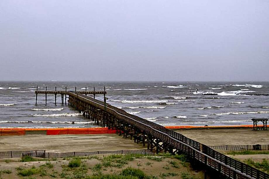 Heavy surf created by Hurricane Alex washes up against oil containment boom on the coast of Grand Isle State Park Beach in Grand Isle, Louisiana, U.S., on Wednesday, June 30, 2010. Alex, the first hurricane of the Atlantic season, closed oil and gas platforms in the Gulf of Mexico and caused waves as high as 8 feet in the BP Plc Deepwater Horizon oil spill area. Photographer: Derick E. Hingle/Bloomberg Photo: Derick E. Hingle, Bloomberg