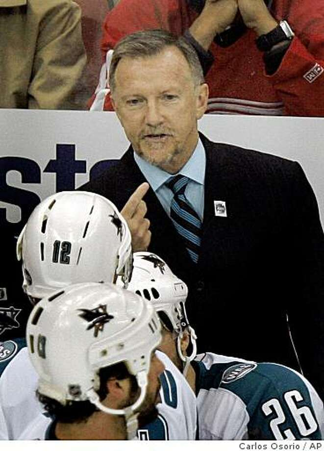 San Jose Sharks hockey coach Ron Wilson talks to his team during a timeout in the third period of Game 1 of their Western Conference semifinal series against the Detroit Red Wings in Detroit, Thursday, April 26, 2007. The Sharks won 2-0. (AP Photo/Carlos Osorio) Ran on: 05-04-2007 Photo: Carlos Osorio, AP