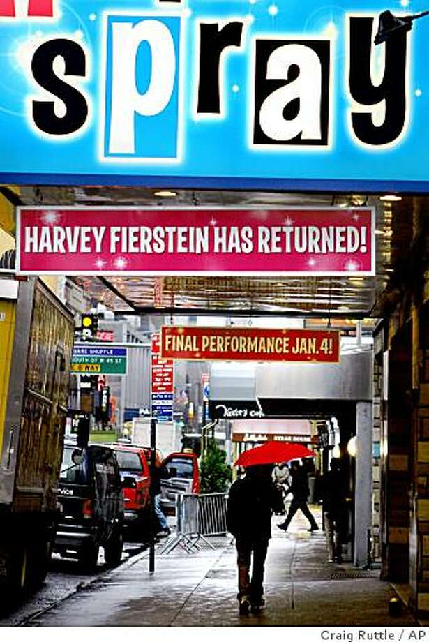 """Pedestrians walk near the marquee of the Broadway show """"Hairspray"""" at the Neil Simon Theatre in New York, Tuesday, Nov. 25, 2008. Several Broadway shows are scheduled to close in January due to the recession and declining ticket sales, including """"Young Frankenstein,"""" """"Hairspray,"""" """"13,"""" """"Monty Python's Spamalot,"""" and """"Spring Awakening."""" (AP Photo/Craig Ruttle) Photo: Craig Ruttle, AP"""