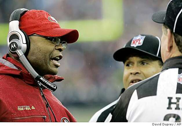 San Francisco 49ers coach Mike Singletary talks with officials during the first half of the NFL football game at Ralph Wilson Stadium in Orchard Park, N.Y., Sunday, Nov. 30, 2008. The 49ers won 10-3. (AP Photo/David Duprey) Photo: David Duprey, AP