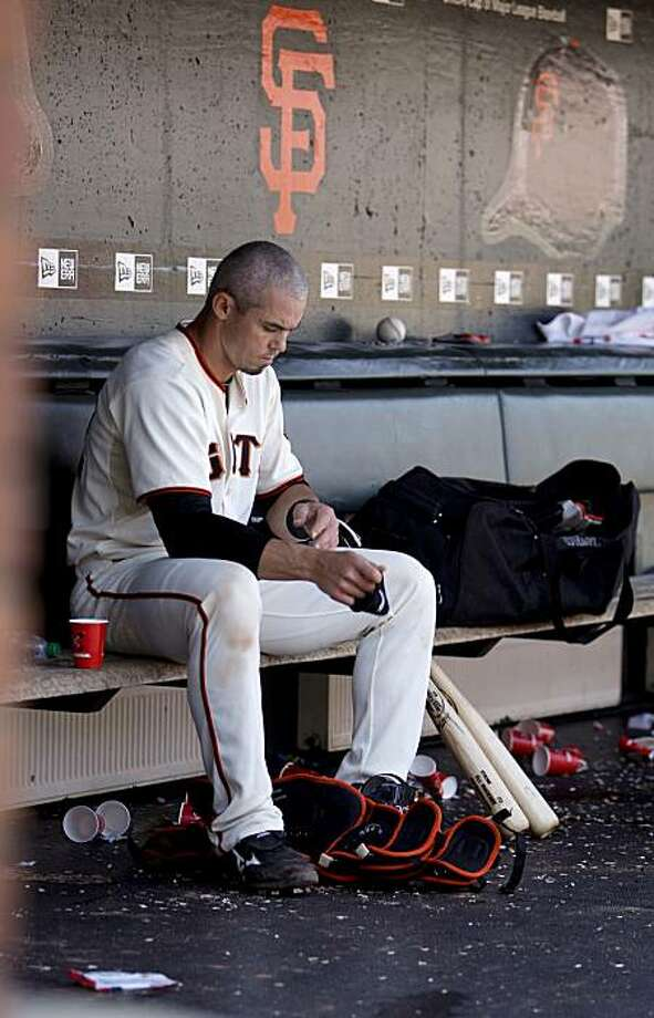 San Francisco Giants catcher Eli Whiteside packs up his gear after a loss to Los Angeles Dodgers in San Francisco on Wednesday. Photo: Michael Macor, The Chronicle