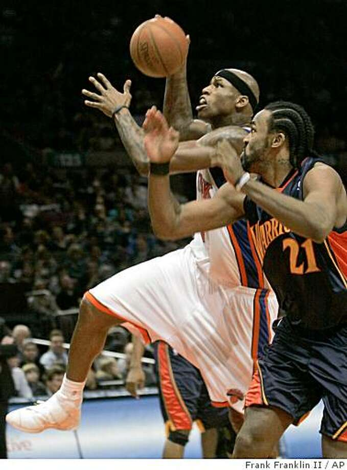 New York Knicks' Al Harrington drives past Golden State Warriors' Ronny Turiaf (21) during the first half of an NBA basketball game Saturday, Nov. 29, 2008 at Madison Square Garden in New York.  (AP Photo/Frank Franklin II) Photo: Frank Franklin II, AP