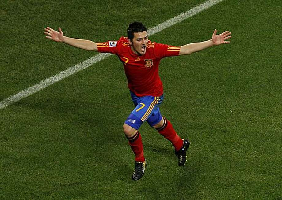 Spain's David Villa celebrates after scoring the opening goal during the World Cup round of 16 soccer match between Spain and Portugal at the Green Point stadium in Cape Town, South Africa, Tuesday, June 29, 2010. Photo: Roberto Candia, AP