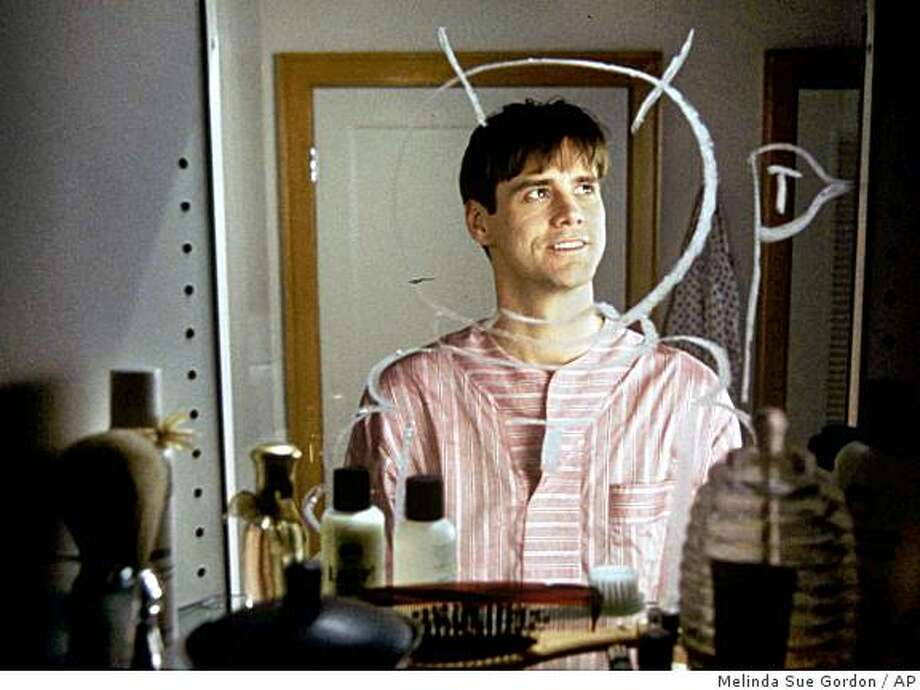 "** FILE ** This undated file image provided by Paramount Pictures shows Jim Carrey starring as Truman Burbank in the 1998 movie ""The Truman Show,"" in which Carrey's character discovers every moment of his life has been broadcast. Now doctors have given the name ""Truman syndrome,"" to a delusion afflicting patients who believe they are living their lives in reality TV shows. (AP Photo/Paramount Pictures, Melinda Sue Gordon, file) ** NO SALES ** Photo: Melinda Sue Gordon, AP"