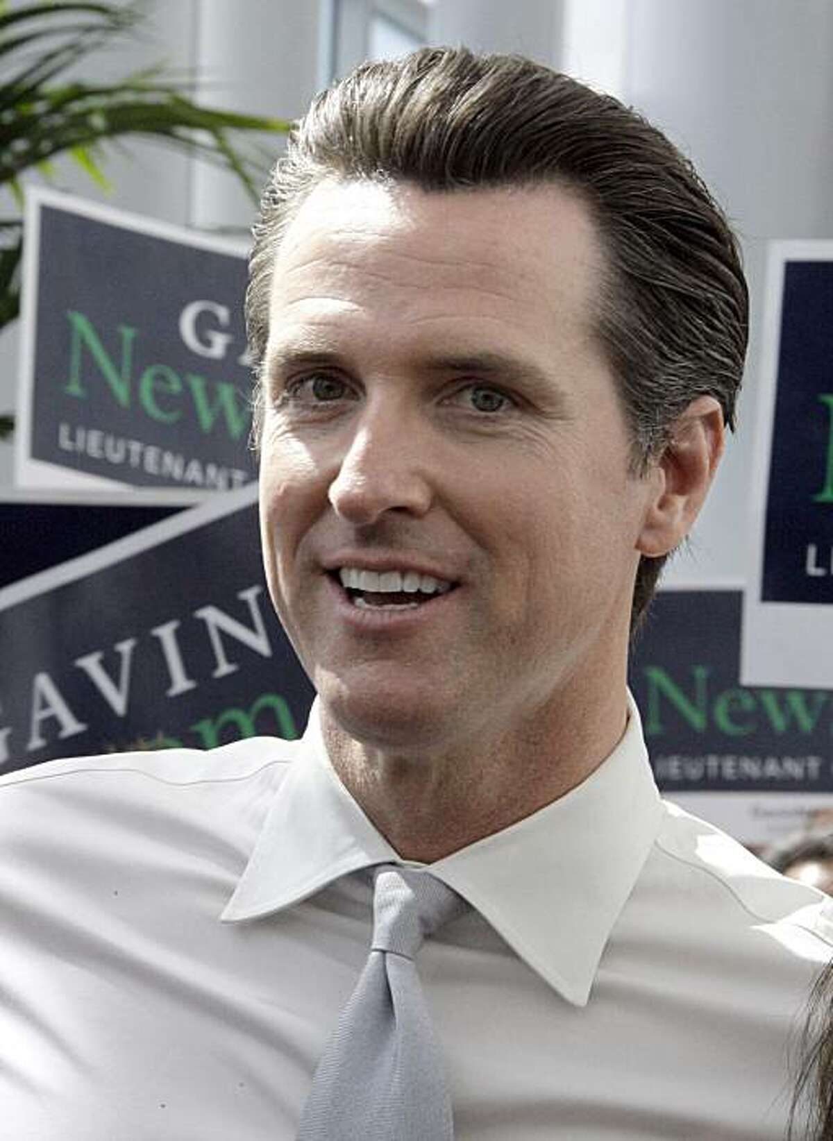 FILE - In this April 17, 2010, San Francisco Mayor and candidate for the Democratic nomination for Lieutenant Governor Gavin Newsom in the June primary, walks through the crowd at the California Democratic Convention in Los Angeles. Newsom is challengedby Los Angeles City Councilwoman Janice Hahn.