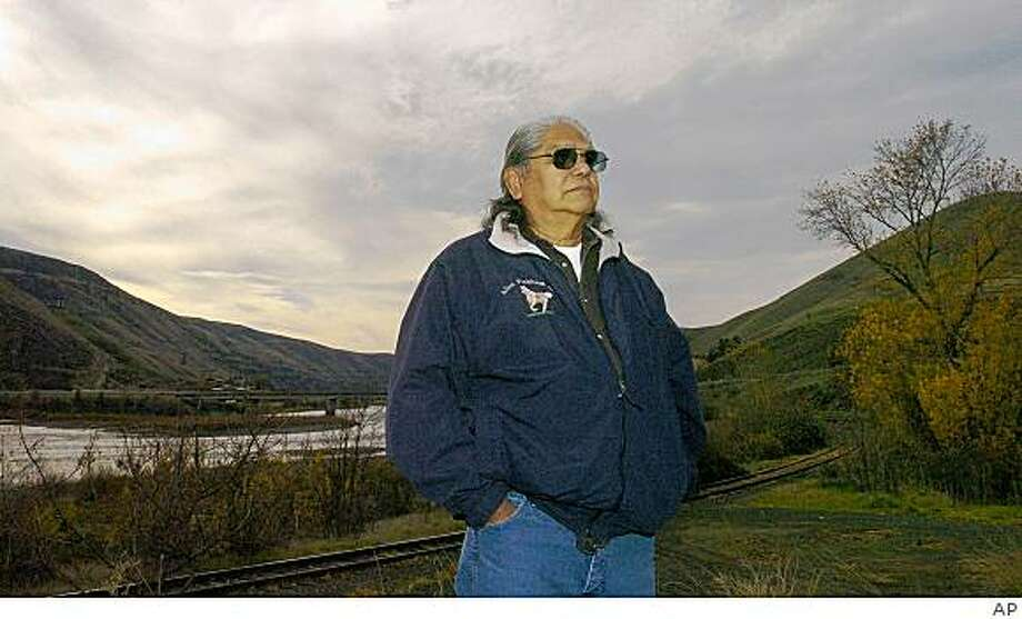Allen Pinkham stands along the banks of the Clearwater River Tuesday, November 18, 2008 east of Lewiston, Idaho, near the site where a Jefferson Peace Medal believed to have been given out by Lewis and Clark to, was uncovered by Northern Pacific Railroad while exhuming an Indian grave.(AP Photo/Kyle Mills) Photo: AP