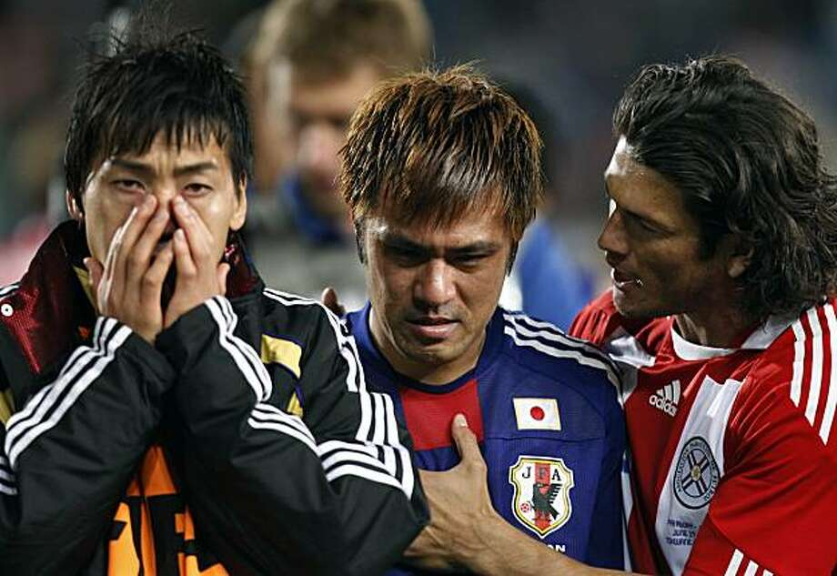 Paraguay's Nelson Haedo Valdez, right, consoles Japan's Yuichi Komano, center, after he missed a shootout penalty during the World Cup round of 16 soccer match between Paraguay and Japan at the Loftus Versfeld Stadium in Pretoria, South Africa, Tuesday, June 29, 2010. Paraguay advanced to the World Cup quarterfinals for the first time with a 5-3 victory over Japan in penalty kicks after a 0-0 draw. Photo: Luca Bruno, AP