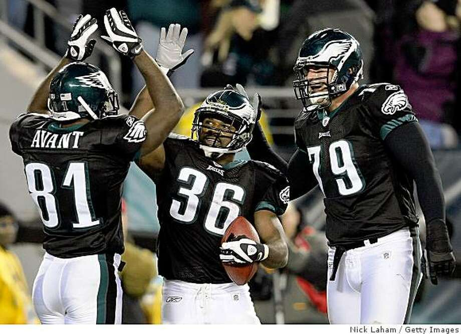 PHILADELPHIA - NOVEMBER 27:  (L-R) Jason Avant #81, Brian Westbrook #36 and Todd Herremans #79  of the Philadelphia Eagles celebrate Westbrook's third touchdown against the Arizona Cardinals at Lincoln Financial Field on November 27, 2008 in Philadelphia, Pennsylvania.  (Photo by Nick Laham/Getty Images) Photo: Nick Laham, Getty Images
