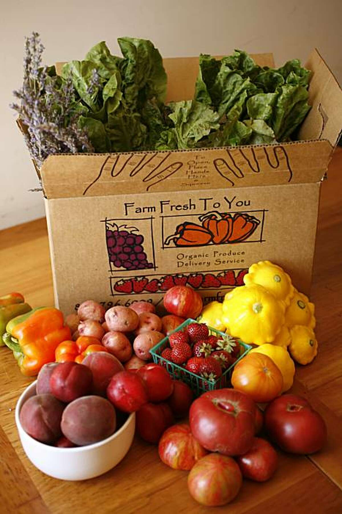 """Julie Caskey's box of fruits and vegetables for her family, delivered by Capay's """"Farm Fresh to You"""" to her home in San Francisco, Calif., on June 18, 2008 Photo by Craig Lee / The Chronicle"""