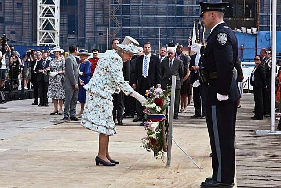 Britain's Queen Elizabeth II places a wreath in remembrance of the victims of the Sept. 11, 2001 terrorist attacks on the World Trade Center site, Tuesday, July 6, 2010 in New York. Photo: Fred R. Conrad, AP
