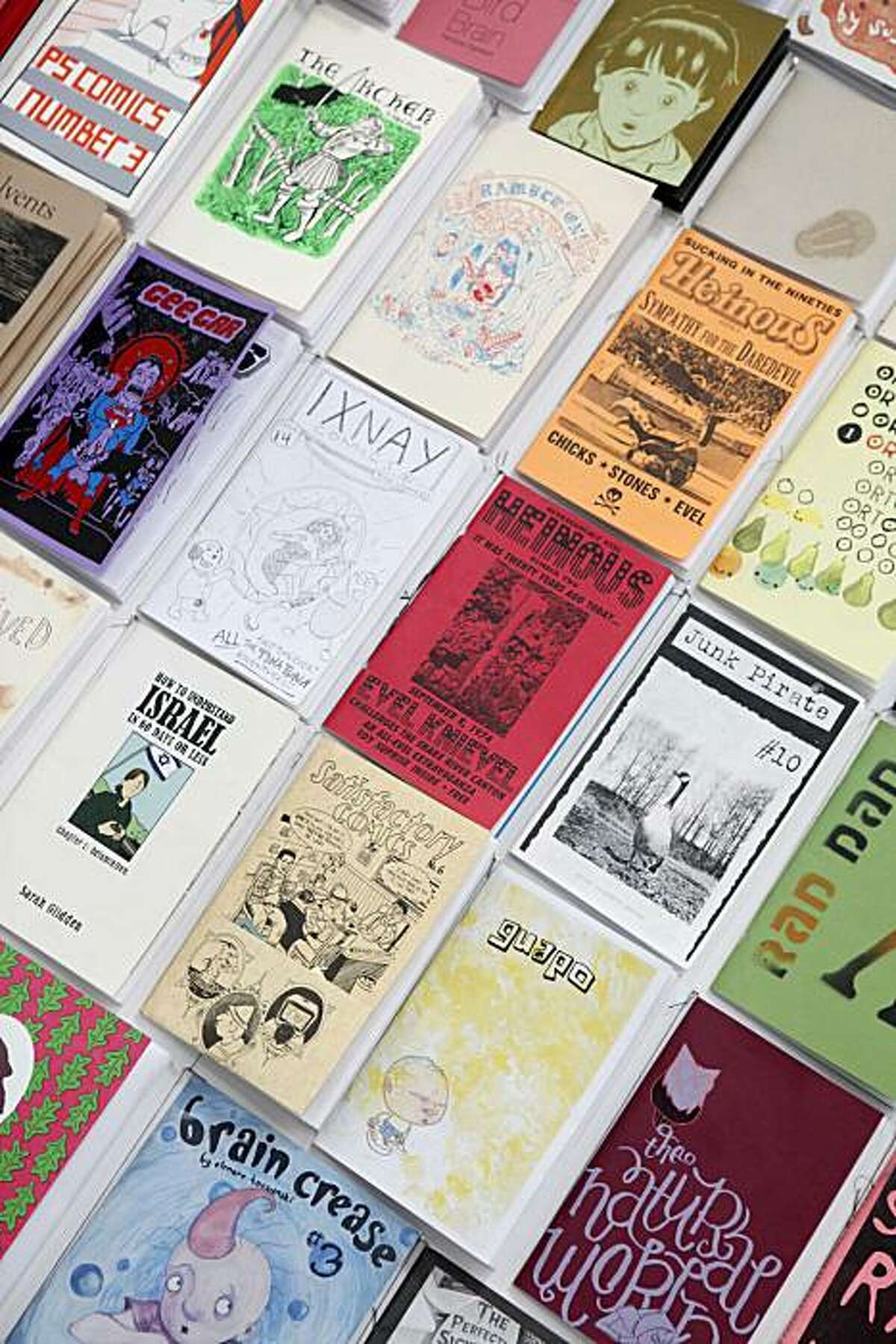 Photocopied zines hang on the wall at Levi's Workshop, an eight-week long multi-use print shop and events venue on Tuesday June 29, 2010 in San Francisco, Calif.