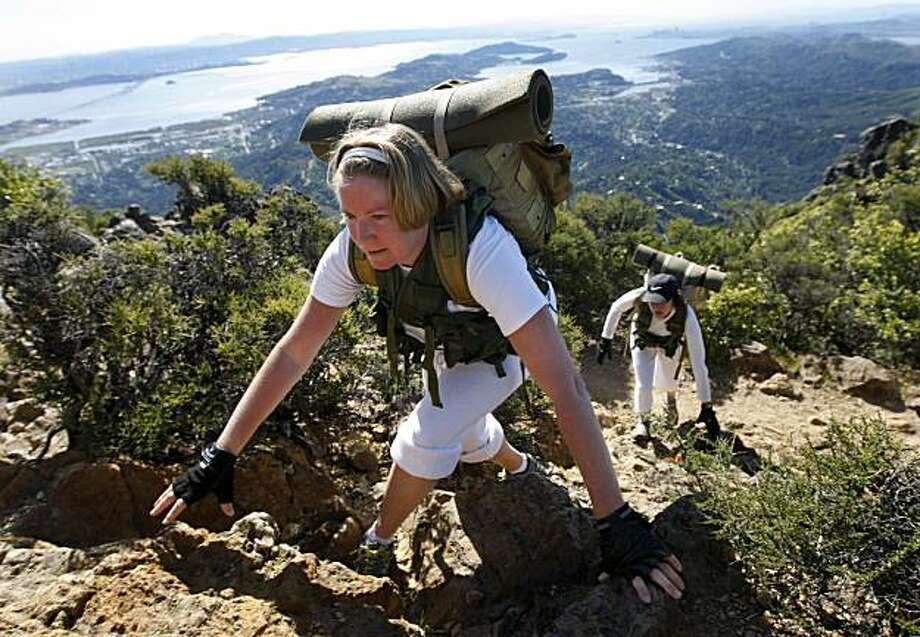 Katharine Holland climbs up steep terrain near the east peak in Mount Tamalpais State Park, Calif., on Thursday, May 6, 2010. Photo: Paul Chinn, The Chronicle